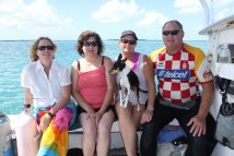 Karen Meyer, producer of Ocean Frontiers and Leesa Cobb, Port Orford Ocean Resource Team with Leah & Phil Gould, Florida Keys Marine Life on their fishing boat.